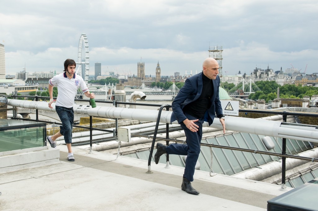 Sacha Baron Cohen and Mark Strong in Columbia Pictures' THE BROTHERS GRIMSBY.